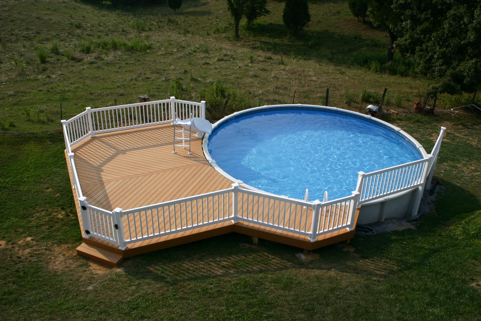 Simple Above Ground Pool Decks Design Open Field White Fence