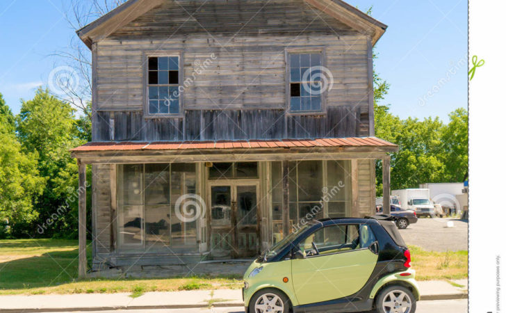 Smart Car Front Old Wooden House